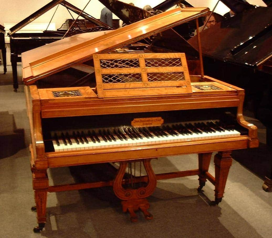 An 1892 7ft Broadwood grand in a decorative and gilted satinwood case
